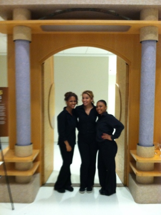 3 pretty ladies in black, standing in front of Oprah's doors :-)