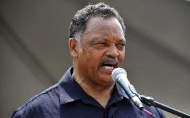 Rev. Jesse Jackson speaks during a rally in Hart Plaza which followed the Freedom Walk down Woodward Avenue to commemorate Martin Luther King Jr.'s historic march 50 years ago, Saturday, June 22, 2013.