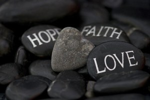 6384266-black-pebble-with-engraved-message-love-faith-hope-and-stone-heart